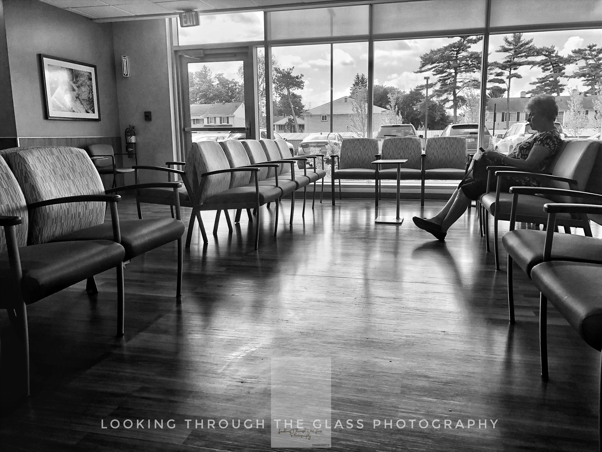 By Her LonesomeSilhouette of a woman down in black and white in a hospital waiting room.